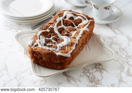 Country Apple Fritter Loaf Cake With Icing At Tea Time
