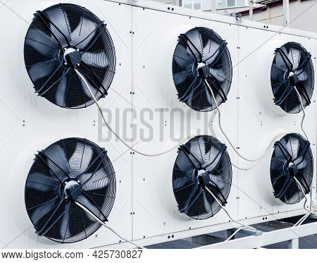 Air Conditioners On The Roof Of An Industrial Building. Hvac