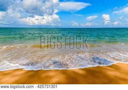 Beautiful Beach And Sea With Blue Sky Background At Mai Khao Beach Phuket, Thailand. Sunny Day Trave