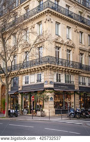 2019, December, 22, Paris, France - Corner Of The House With Glowing Shop Windows Of Street Cafe Or