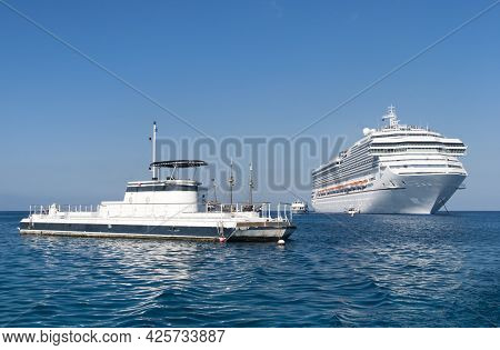The Morning View Of A Tourist Submarine Boat And A Cruise Liner Drifting Near Grand Cayman Island (c