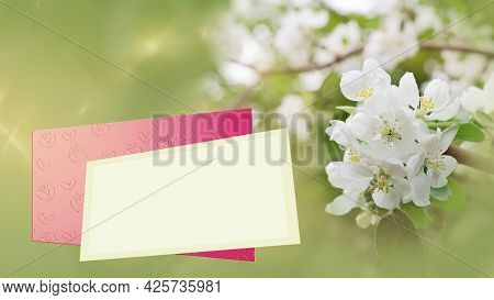 Flowering Branches On A Defocused Background, A Text Frame And An Envelope With Embossed Hearts