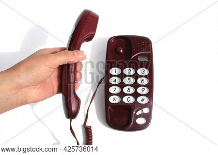 Female Hands Hold The Telephone Receiver And Press The Button