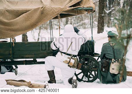 Hidden Re-enactor Dressed As German Wehrmacht Infantry Soldier In World War Ii Soldiers Sitting In A