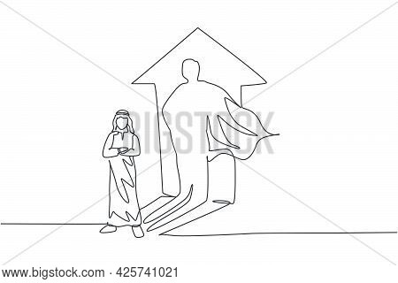 Single Continuous Line Drawing Of Young Arabian Businessman Standing With Super Hero Shadow On Wall.