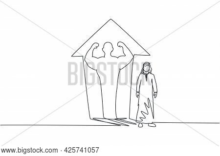Continuous One Line Drawing Of Young Arab Businessman Standing With Muscular Shadow On Wall. Success