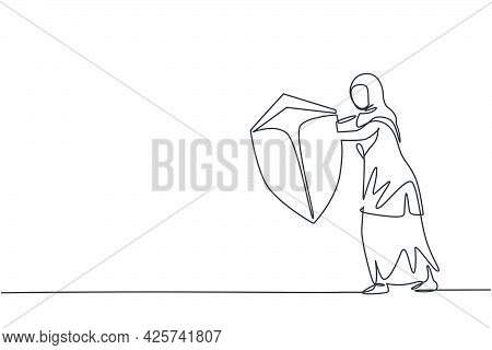 Single One Line Drawing Young Arabian Businesswoman Holding Defense Shield To Protect Herself. Busin