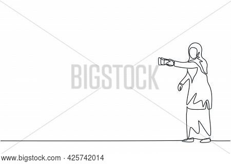 Continuous One Line Drawing Of Young Arabic Female Worker Holding Flashlight To Walk Carefully. Succ