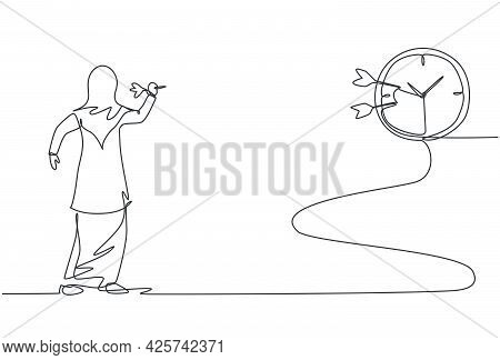 Single One Line Drawing Of Young Arabian Business Woman Hit The Analog Clock On Wall With Dart Arrow