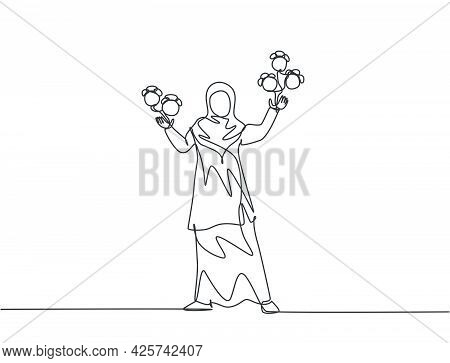 Single One Line Drawing Of Young Arabian Business Woman Juggling Alarm Analog Clock With Her Hands.