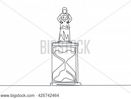 Single One Line Drawing Of Young Arabian Business Woman Standing Above Hourglass. Symbol To Show Tim