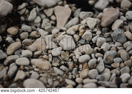 Pebbles On The Beach With Focus In The Center Of The Frame And Blur Closer And Further Away