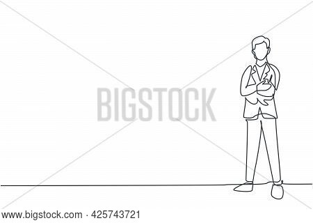 Single Continuous Line Drawing Of Young Handsome Male Worker Pose Standing Elegantly At Office. Prof