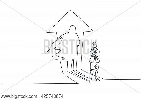 Single One Line Drawing Of Young Smart Businesswoman Standing With Superhero Shadow Behind Her. Busi