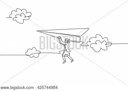Single One Line Drawing Young Businesswoman Hanging On Flying Paper Plane At The Sky. Business Goal
