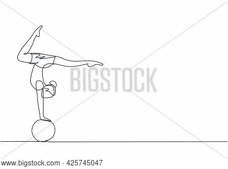 Single One Line Drawing A Female Acrobat Performs A Hand Stand On A Circus Ball While Performing A B
