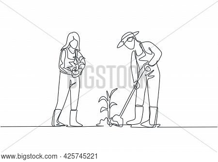 Single Continuous Line Drawing Young Couple Farmer Shoveled The Soil With The Plants Using A Shovel.