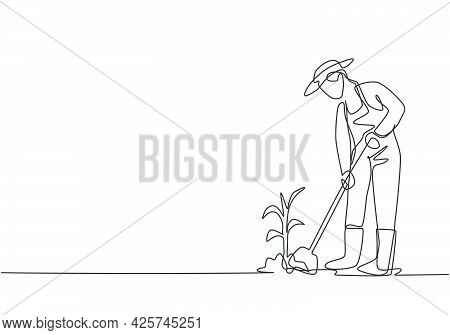 Single Continuous Line Drawing Young Female Farmer Shoveled The Soil With The Plants Using A Shovel.