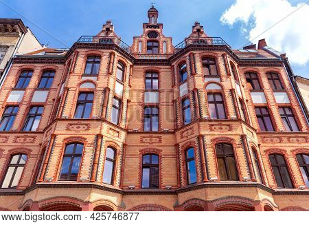 Poznan. Beautiful Facade Of A Brick House On A Sunny Day.