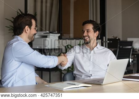 Smiling Hr Manager Shaking Successful Candidate Hand At Job Interview