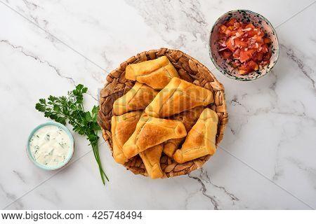 Fried Empanadas With Cilantro, Meat, Egg, Tomato And Chili Sauce On White Background. Latin American