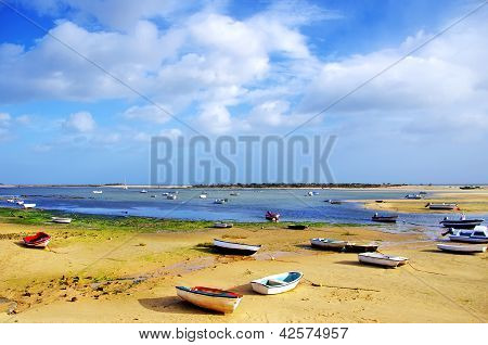 Small boats on Ria Formosa Algarve Portugal