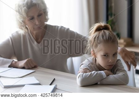 Old Lady Teacher Look At Disobedient Girl Refusing To Study