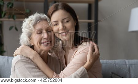 Elderly Mother Grown Daughter Hug With Closed Eyes Touch Heads