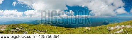Mountain Panorama On A Sunny Day. Beautiful Nature Background. Gorgeous Cloudscape Above The Mountai