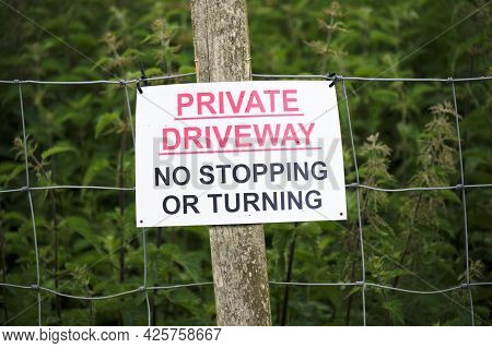 No Parking Private Driveway Sign Outside House