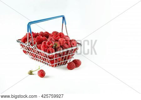 Mini Grocery Shopping Basket With Fresh Raspberries On A White Background. Food Photo