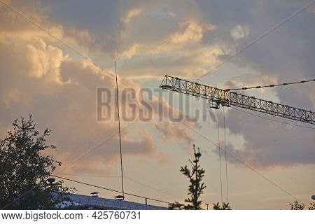 Evening Landscape And Full Moon With A Tower Crane