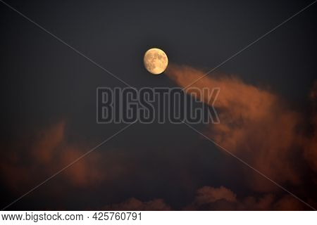Full Moon And Clouds In The Late Evening