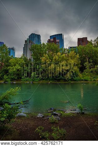 Moody Clouds Over The Calgary Skyline And River