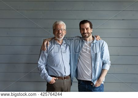 Happy Mature Senior 70s Father And Grown Son Standing Together