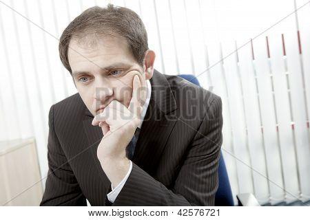 Depressed Businessman Thinking