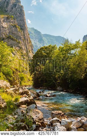 Landscape With Turquoise River Flowing Through A Forest. Rio Cares In Picos De Europa, Asturias, Spa