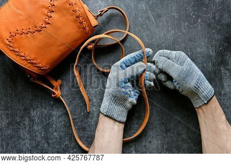 Leather Professional Makes A Hole In The Shoulder Leather Strap Of A Womans Purse, Top View, Occupat