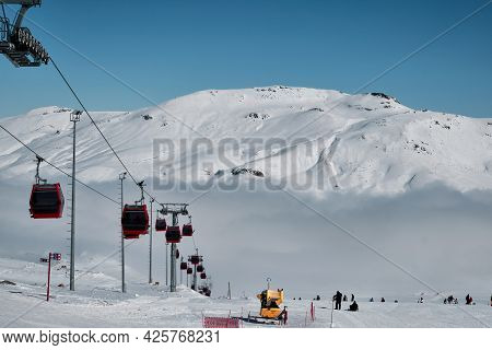 Ropeway On The Slope Of Erciyes Mount Covered By Cloud. Snow Covered Top Of Erciyes Stratovolcano. C
