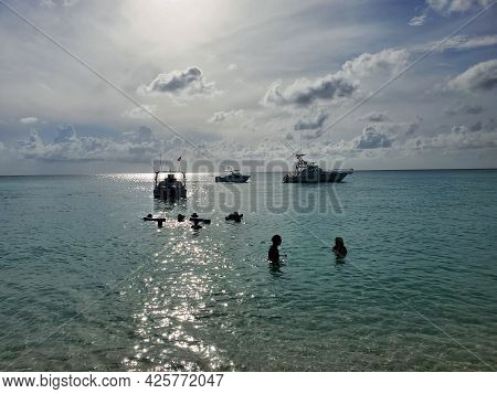 Boating Visitors Enjoy Late Afternoon Off Radio Beach In North Bimini, Bahamas With Boats Anchored I