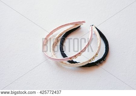Yellow, Black And Pink Silk Hair Hoop Isolated On White. Flat Lay Hairdressing Tools And Accessories