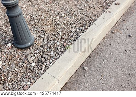 The Curb Of The Pavement With Rubble, The Street Lamp, Not Finished