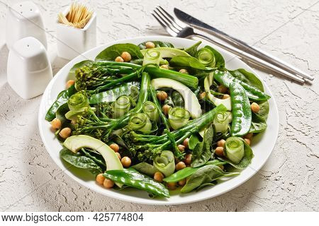 Green Vegetable Salad Of Sauteed Tenderstem Broccoli, Snow Peas, Avocado, Cucumber, Chickpeas, Baby