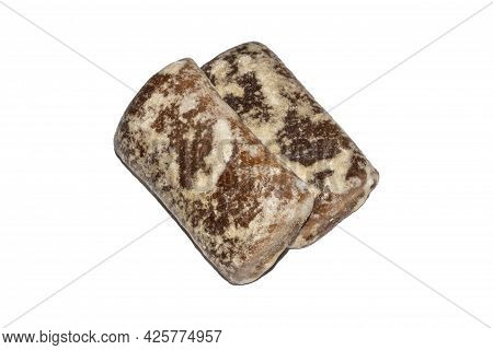Rectangular Gingerbread With Filling On A White Background Top View.gingerbread With Fruit Filling.