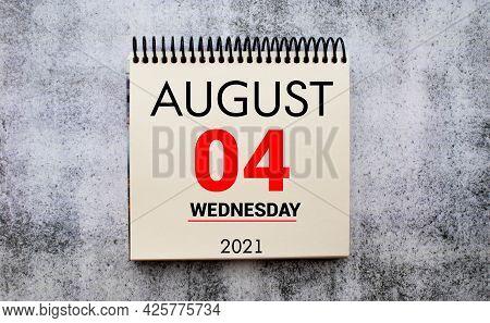 Save The Date Written On A Calendar - August 04
