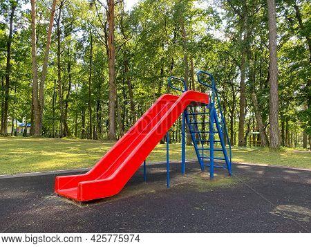 Children\'s Playground. A Slide For Children To Ride. Equipped Children\'s Playground