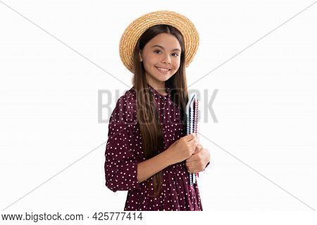 Smiling Child In Straw Hat Hold School Copybook For Studying Isolated On White, Childhood