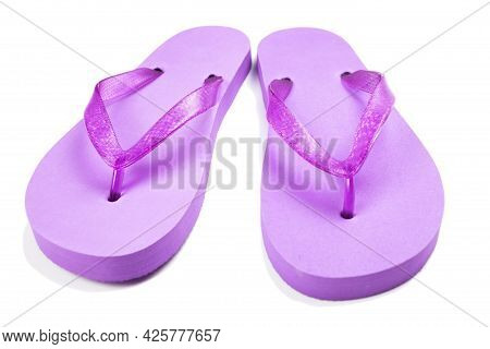 Purple Rubber Beach Flip Flops On A White Background, Isolate
