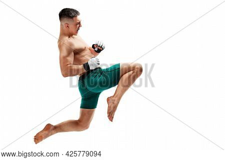 Mma. Jumping Knee Kick. Male Fighter Jumping With A Knee Kick. Sport. Isolated