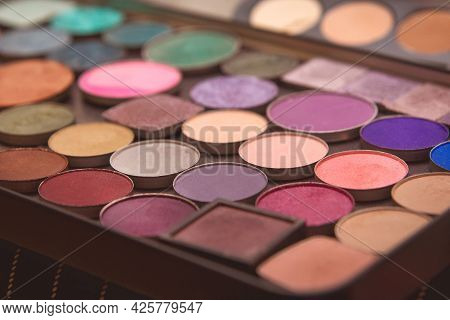 Multi-colored Eye And Makeup Palette Shades, Women's Cosmetics Close-up.